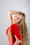 Girl in a red dress. Beautiful young girl in a red dress Royalty Free Stock Images