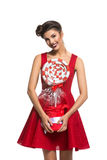 Girl in red dress with big candy Stock Images