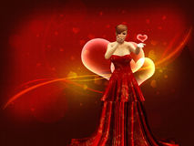Girl in red dress blow heart Royalty Free Stock Image