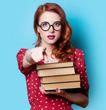 Girl in red dress with books Royalty Free Stock Photos