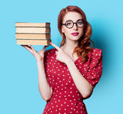 Girl in red dress with books Royalty Free Stock Images