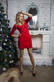 Girl in red dress with Christmas champagne Royalty Free Stock Photos