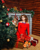 Girl in red dress Christmas tree Stock Images