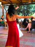 Girl in red dress dancing. royalty free stock photos