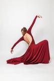 Girl in red dress dancing in the studio Stock Image