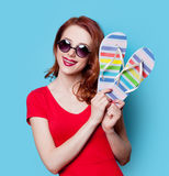 Girl in red dress with flip flops Stock Photography