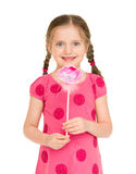 Girl in a red dress with flower. studio shot Stock Photos