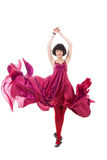 Girl in red dress flying in a jump Royalty Free Stock Photo