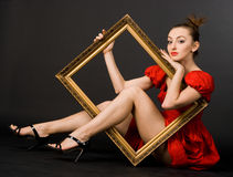 Girl in red dress with frame Stock Photo