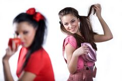Girl in red dress and girl with handbag Stock Image