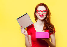Girl in red dress with glasses and gift box Stock Photos