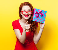 Girl in red dress with glasses and gift box Royalty Free Stock Photos
