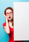 Girl in red dress and glasses with white board Stock Images
