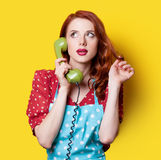 Girl in red dress with green dial phone Royalty Free Stock Images