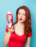 Girl in red dress with gumshoe Stock Photos
