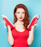Girl in red dress with gumshoes Stock Photography