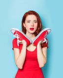 Girl in red dress with gumshoes Royalty Free Stock Photo