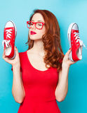 Girl in red dress with gumshoes Royalty Free Stock Photography