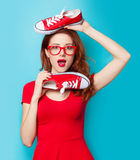 Girl in red dress with gumshoes Stock Image