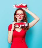 Girl in red dress with gumshoes Stock Photos