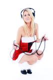 Girl in red dress and headphones Royalty Free Stock Photos