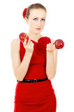 The girl in red dress holding a Apple Stock Photo
