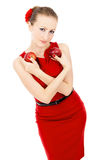 The girl in red dress holding a Apple Royalty Free Stock Photography