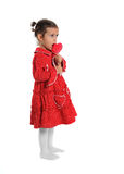 Girl in a red dress holding a lollipop Royalty Free Stock Photos