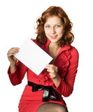 Girl in a red dress holding a piece of white paper Stock Photography