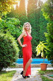 Girl in red dress on holiday Royalty Free Stock Photos