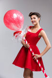 Girl in red dress with huge lollipop Royalty Free Stock Photography