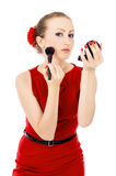 The girl in the red dress, imposes a make-up Royalty Free Stock Image