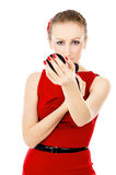 The girl in the red dress, imposes a make-up Stock Photography