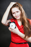 Girl in red dress late with alarm clock. Girl in red dress late Royalty Free Stock Photo