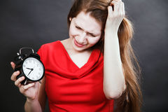 Girl in red dress late with alarm clock. Girl in red dress late Stock Photos