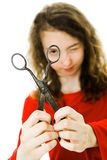 Girl in red dress making fun with vintage scissors - looking stock photo