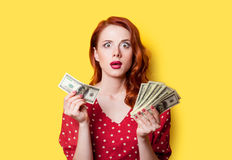 Girl in red dress with money Royalty Free Stock Images