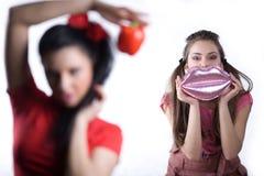 Girl in red dress and nice girl with handbag Stock Photo