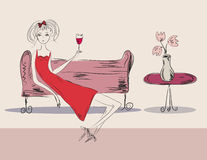 Girl in red dress at the party. With a drink Royalty Free Stock Photography