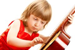 Girl in red dress play the guitar Stock Photos