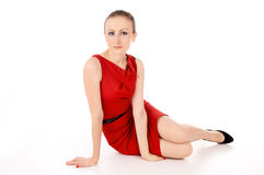 The girl in the red dress posing Stock Photo