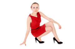 The girl in the red dress posing Royalty Free Stock Photography