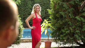 Girl in red dress posing in the park.  stock video footage