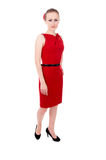 The girl in the red dress posing, standing Royalty Free Stock Image