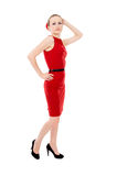 The girl in the red dress posing, standing Royalty Free Stock Photo