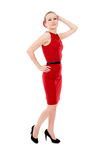 The girl in the red dress posing, standing Royalty Free Stock Photography