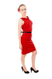 The girl in the red dress posing, standing Stock Image