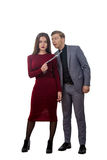 Girl in a red dress pulling man by tie Stock Photo