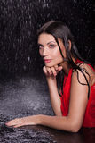 Girl in a red dress in the rain Royalty Free Stock Photos
