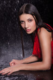 Girl in a red dress in the rain Stock Photography